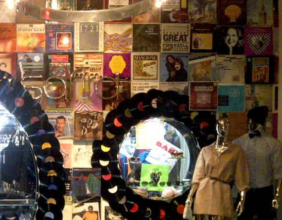 store window with records and mannequins
