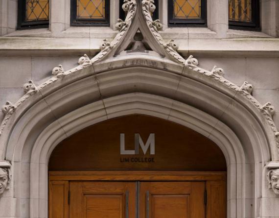 close up of brick building entrance with LIM logo