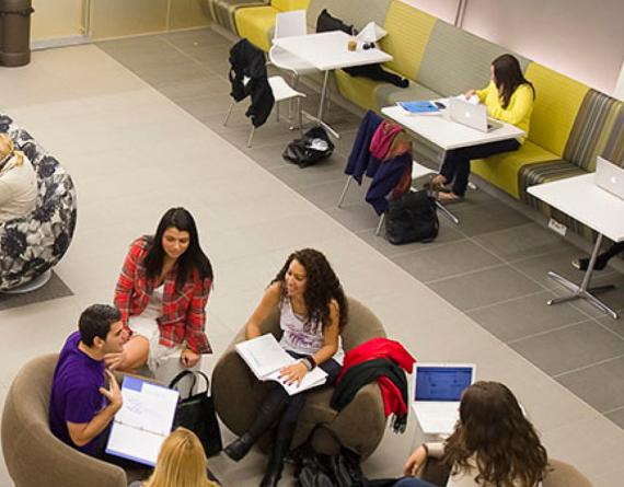 students sitting in a circle with opened books