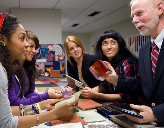 students and a profesor with fabric swatches