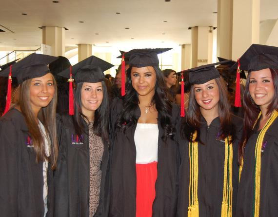 group of girls in graduation caps and gowns