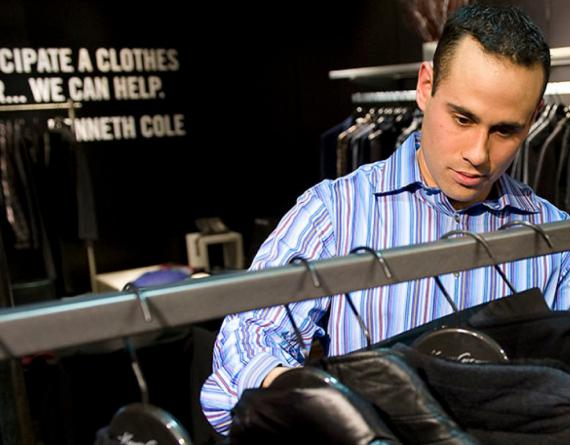 man looking at clothing rack