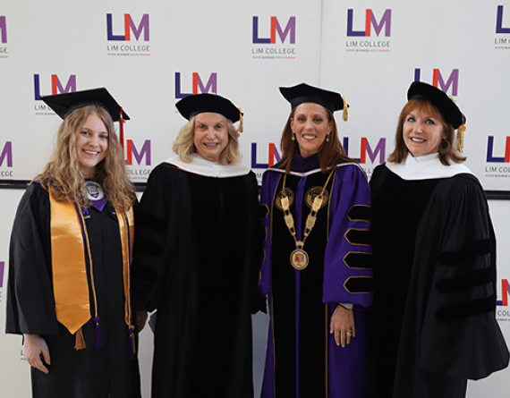 four women in graduation caps and gowns